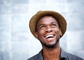 pic of cheer-up  - Close up portrait of a cheerful young man laughing and looking up - JPG