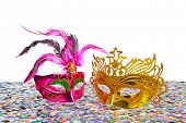 Carnival masks on confetti and white background