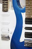 Many electric guitars