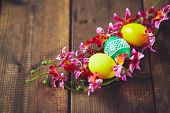 Easter painted eggs inside orchid wreath