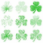 Vector set of scribbled hand drawn green clovers