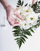 Woman with soft skin making a bouquet