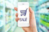 stock photo of supermarket  - Mobile shopping concept - JPG