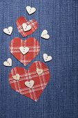 picture of applique  - Heart symbol in denim trimmed with other tissue. Applique card for congratulations.