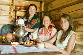 stock photo of nea  - Women nea traditional russian samovar in russian traditional interior - JPG