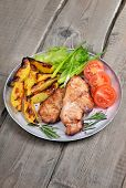 Grilled Pork Chop On Rustic Table