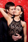 Elegant Couple On Red.