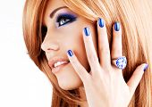 image of nail  - portrait of a beautiful woman with blue nails - JPG