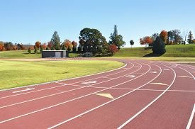 foto of race track  - A running track with marked lanes for track and field exercises and foot races - JPG