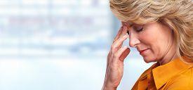 stock photo of depressed  - Woman having migraine headache - JPG