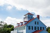 foto of gabled dormer window  - Cliassic white home with red roof dormers and widows walk - JPG