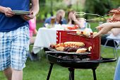 picture of frazzled  - Friends having nice fun on grill party - JPG