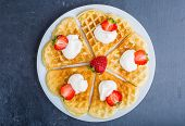 pic of whipping  - Waffles with fresh strawberry and whipped cream on a white plate - JPG