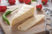 picture of hunter  - Close up of a block of spicy hunter cheese on cutting board - JPG