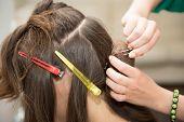 stock photo of barber  - Barber creates beautiful wedding hairstyle girl Barber - JPG