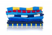 picture of neat  - Neatly folded colourful summer shirts on a white background - JPG