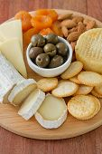 stock photo of fruit platter  - cheese with olives dry fruits cookies on tray - JPG