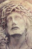 stock photo of passion christ  - Close up dramatic statue of crucified Jesus Christ  - JPG