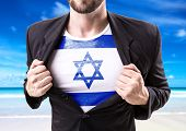picture of israel people  - Businessman stretching suit with Israel on beach background - JPG
