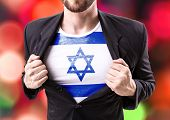foto of israel people  - Businessman stretching suit with Israel on bokeh background - JPG