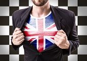 picture of united we stand  - Businessman stretching suit with United Kingdom Flag on checkered background - JPG