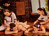 picture of panchakarma  - Couple  having oil Ayurveda spa treatment on open window background - JPG