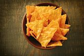 image of nachos  - Tasty nachos in color bowl - JPG