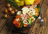 pic of redfish  - Fried fish with vegetables in the pot - JPG
