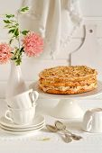 stock photo of shortbread  - shortbread cake with meringue and nuts on a light wooden background - JPG