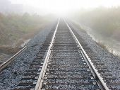 Railroad Tracks In Fog