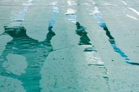 picture of tarp  - abstract background texture wet rain stripes on a green tarpaulin narrow depth of field  - JPG