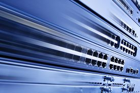 stock photo of telecommunications equipment  - High Speed Internet, Web Hosting Information Technology. Fast IT Telecommunication Equipment, Router Switch Network Telecom Electronic for Data Center ** Note: Shallow depth of field - JPG