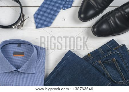 Set Of Men\'s Clothing And Shoes On Wooden Background. Men Accessories. Black Elegant Accessories Pie