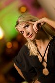 picture of night-club  - Beautiful young woman relaxing in a night club - JPG