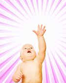 Little child over abstract pink background