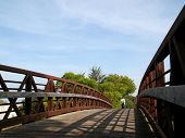 Woman Walking On Rusty Bridge