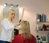 Female hairdresser working in beauty salon