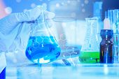 Scientist With Equipment And Science Experiments ,laboratory Glassware Containing Chemical Liquid, S poster