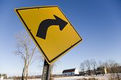 stock photo of veer  - road sign on the side of a country road along side a farm - JPG