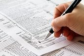 pic of irs  - tax form with human hand and pen - JPG
