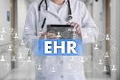 Electronic Health Record. Ehr On The Touch Screen With Medicine Icons On The Background Blur Doctor  poster