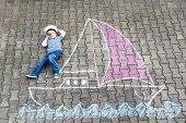 Little Kid Boy As Pirate On Ship Or Sailingboat Picture Painting With Colorful Chalks On Asphalt. Cr poster