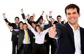 image of thumbs-up  - Business man leading a successful corporate group with thumbs up  - JPG
