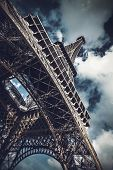 Low-angle view of Eiffel Tower against dramatic cloudy sky, landmark and French tourist attraction i poster