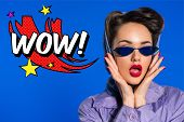 Portrait Of Stylish Woman In Retro Clothing And Sunglasses With Comic Style Wow Sign Isolated On Blu poster