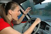 Angry Young Woman Drives A Car