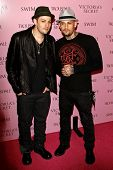 LOS ANGELES - MAR 25: Joel Madden and Benji Madden arrives as Victoria's Secret celebrates the 15th anniversary of the Swim Catalogue at Trousdale in Los Angeles, California on March 25, 2010
