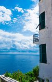 Beautiful view of the lighthouse on the sea. Beautiful coast of the Adriatic Sea. Blue sea white clo poster