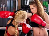 Two boxing women workout in fitness class. Sport exercise two female people. Preparation for Champio poster
