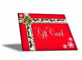 stock photo of card christmas  - Illustration of a pretty red Christmas Gift card envelope decorated with ribbons and holly ornament and text on envelope - JPG